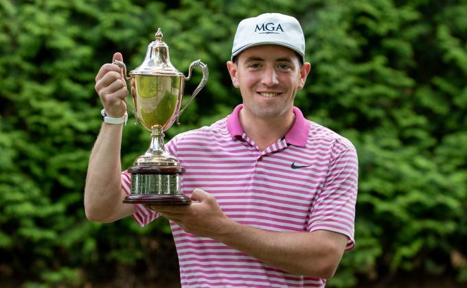 Erik Stauderman with the WGA Public Links Trophy