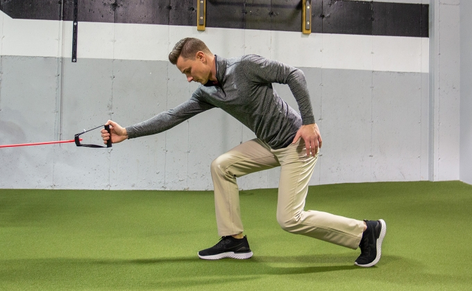 Tyler Campbell using a fixed exercise band