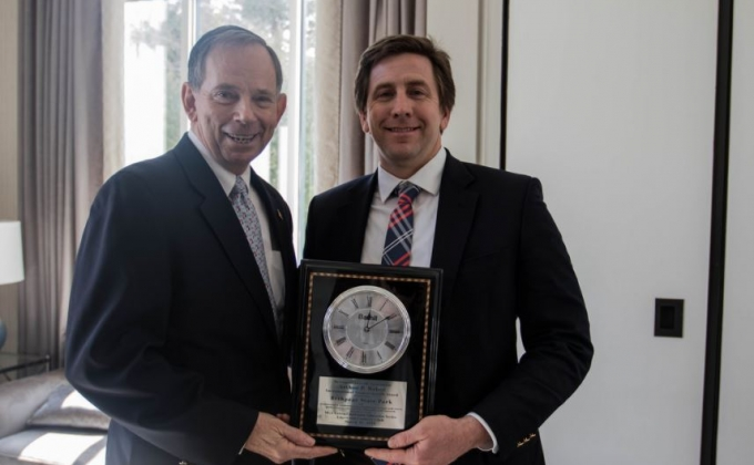 Image of Gene Westmoreland and a man in a suit
