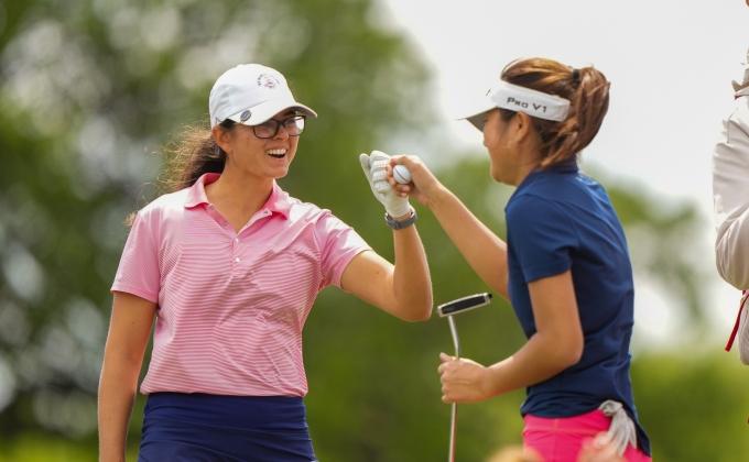 Ami Gianchandani and Kaitlyn Lee fist-bumping