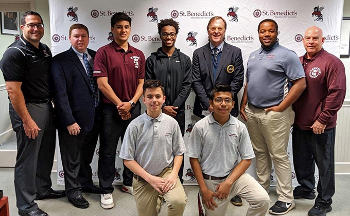 MGA Foundation Director Peter Nicholson with representatives from St. Benedict's Preparatory
