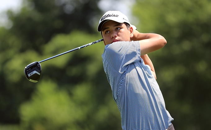 A junior golfer swinging a golf club