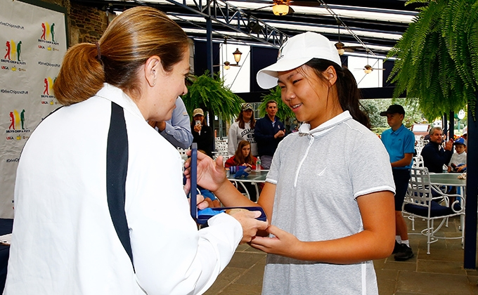 Junior golfer Sophia Li accepting her medal after winning the Drive, Chip and Putt Regional at Winged Foot Golf Club.