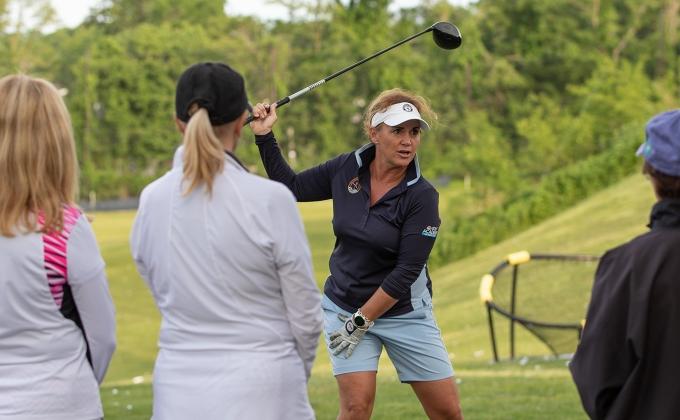 Professional Kelley Brook teaching the golf swing.