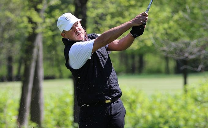 image of golfer swinging a golf club