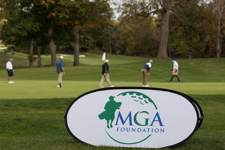 MGA Foundation Banner with golfers in the background