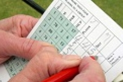Golfer using a scorecard.
