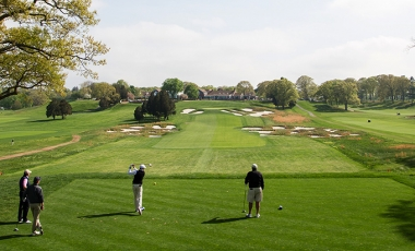 Golfers teeing off on the 18th hole of Bethpage Black