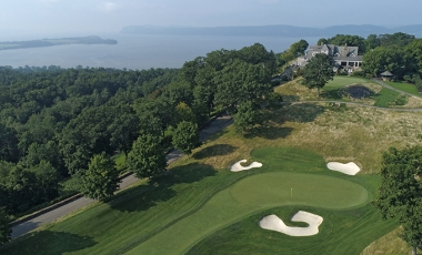 Aerial view of Hudson National Golf Club's 18th green and clubhouse