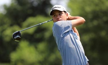 A junior golfer swinging a golf club