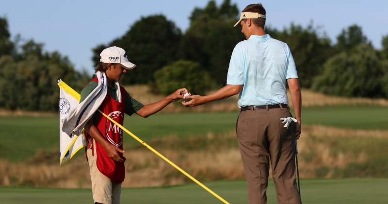 caddie with player