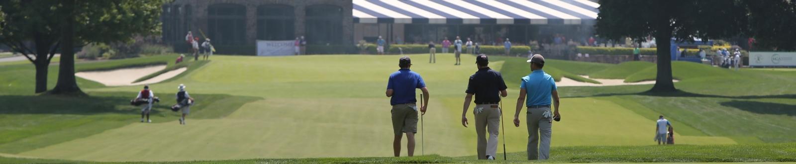 Golfers walking down the fairway