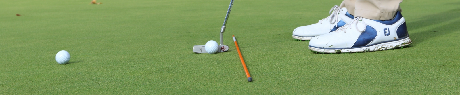 Golfer practicing putting
