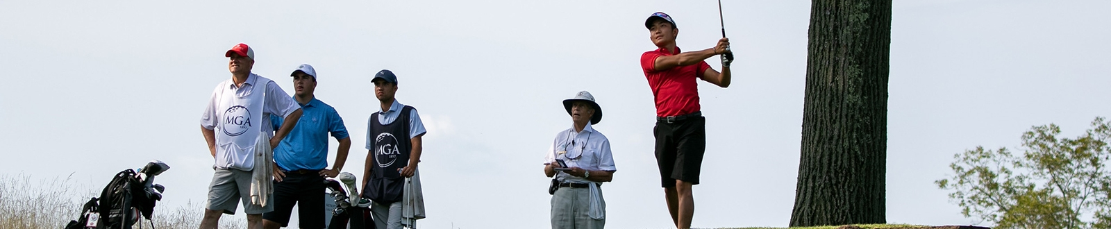 Golfers on a tee box